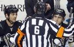 Россиянин Евгений Ромасько стал первым российским арбитром в истории НХЛ